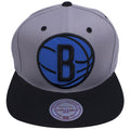 on the front of the Brooklyn Nets XL Logo Reflective Snapback Hat, an extra large Brooklyn Nets logo is embroidered on the front of a snapback hat with blue reflective material
