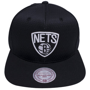 on the front of the brooklyn nets black mesh jersey snapback hat is the brooklyn nets logo embroidered in black and white