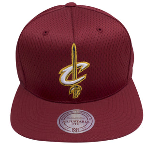 on the front of the Cleveland Cavaliers maroon mesh jersey snap back hat has a Cleveland Cavaliers logo embroidered in white and gold