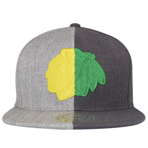 on the front of the blackhawks two tone snapback hat is the blackhawks logo embroidered in yellow and green