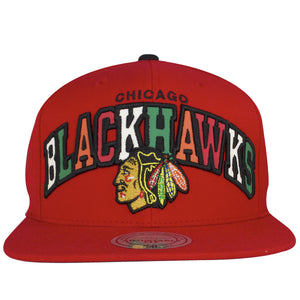 on the front of the Chicago Blackhawks Reflective Lettering snapback hat is a red structured crown, a red flat brim and reflective lettering that says Blackhawks