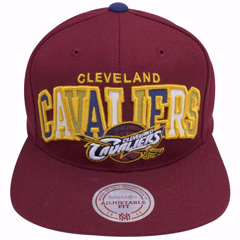 on the front of the cleveland cavaliers maroon reflective lettering snapback hat has the word cleveland cavaliers embroidered in gold with cleveland cavaliers logo beneath the reflective lettering