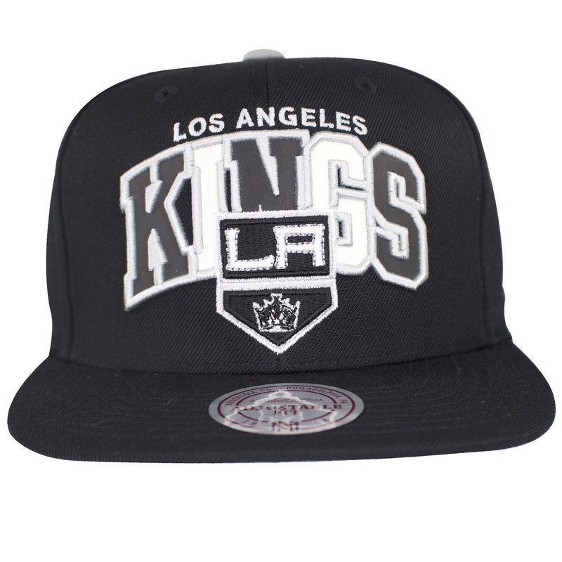 on the front of the Los Angeles Kings reflective lettering snapback hat is the Los Angeles Kings lettering with reflective material and a Los Angeles Kings logo embroidered in black and white