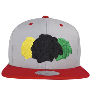 on the front of the Chicago Blackhawks Tri-tone logo snapback hat is the Blackhawks logo embroidered in black, yellow, and green