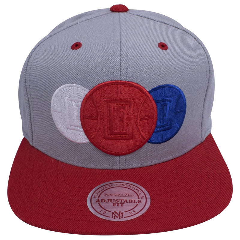 the los angeles clippers tripple stack gray snapback hat features the clipper logo embroidered 3 times in red, white, and blue on the front of the gray crown