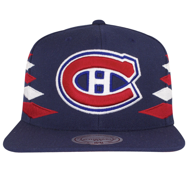 on the front of the montreal canadiens diamond spike snapback hat is a montreal canadiens logo embroidered in red, white, and blue