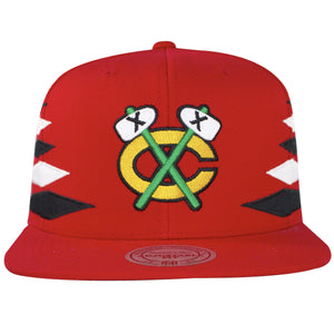 on the front of the chicago blackhawks diamond spikes snapback hat is a chicago blackhawks logo embroidered in yellow, black, white, and green