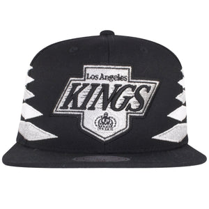 on the front of the los angeles kings diamond spikes snapback hat is the vintage los angeles kings logo embroidered in silver and black