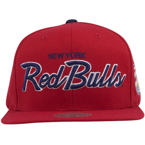 on the front of the new york red bulls snapback hat is the word new york embroidered in navy blue above the script word red bulls embroidered in white and navy blue