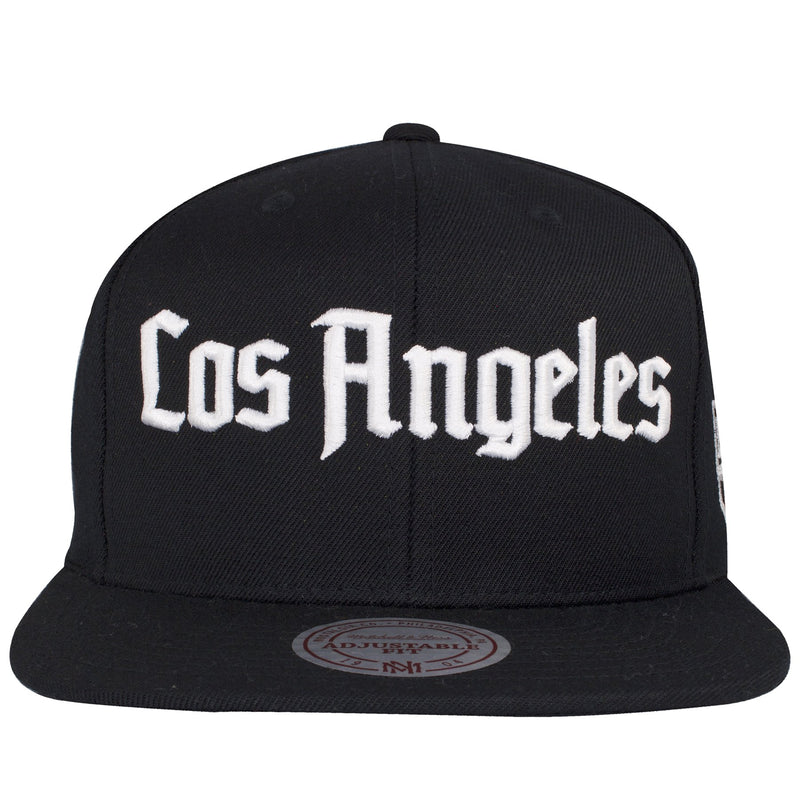 on the front of the Los Angeles Kings Old English lettering snapback hat is the word Los Angeles written in Old English embroidered in white