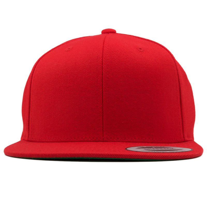 the plain blank red snapback hat is solid red with a structured red crown and a flat red brim