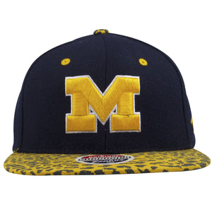 on the front of the university of michigan wolverines snapback hat is the university of michigan M logo embroidered in yellow and white
