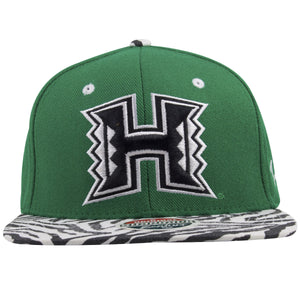 on the front of the university of hawaii green on white and black animal print snapback hat is the rainbow warriors logo embroidered in white and black