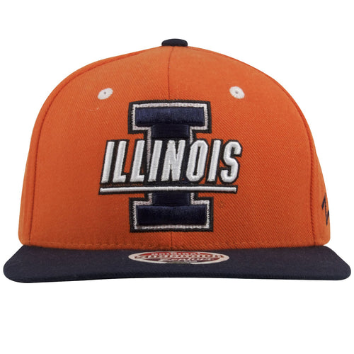 on the front of the university of illinois fighting illini orange on navy blue snapback hat is the capital letter I embroidered in navy blue and white above the word illinois also embroidered in white and navy blue