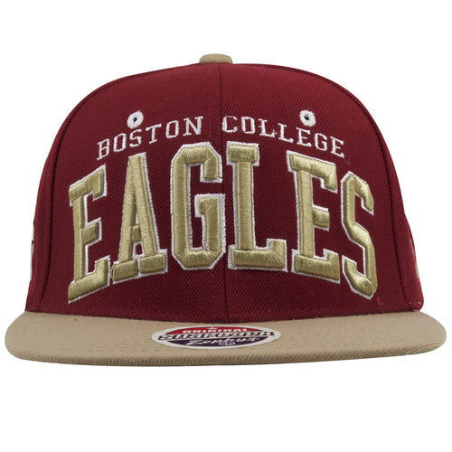 on the front of the boston college snapback hat is the word boston college embroidered in white lettering above a tan eagles wordmark embroidered in tan and white