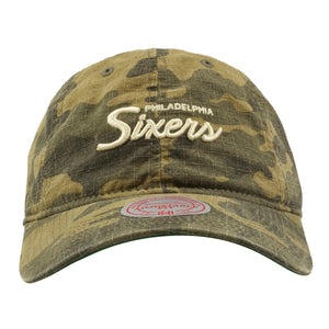 Embroidered on the front of the woodland camouflage dad hat is the word Philadelphia Sixers embroidered