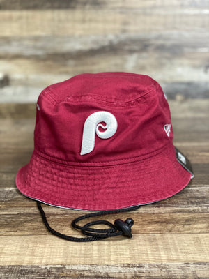 on the front of the Philadelphia Phillies Retro Maroon Team Adventure Bucket Hat is a white vintage P logo on maroon cotton fabric