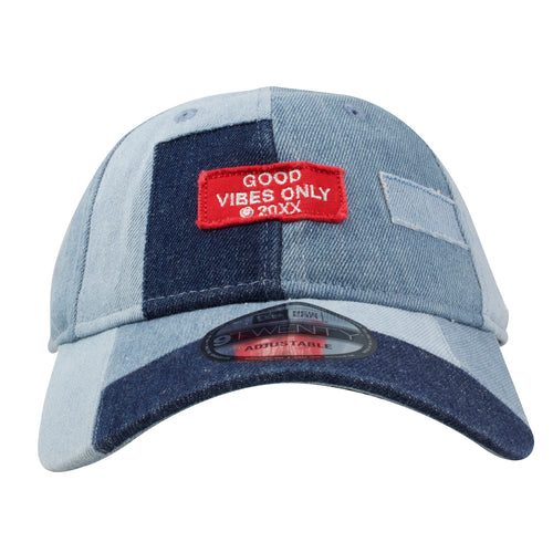 On the front of the denim grunge patch dad hat is a red Good Vibes Only Patch