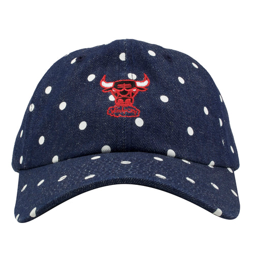 Embroidered on the front of the polka dot Chicago Bulls denim dad hat is the Chicago Bulls logo embroidered in red, black, and white
