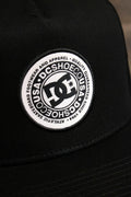"the circle on the Black Circle Patch Snapback Skater Hat | DC Shoes Black Bottom Snap Back Cap says ""DC Shoe Co USA"" in the middle and ""Athletic Skateboard Footwear and Apparel, Quality Guaranteed since 1994"" on it"