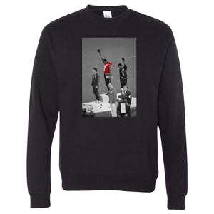 On the front of the 1968 Olympics Black Power Fist crewneck is a photo from the 1968 with the Colin Kaepernick jersey