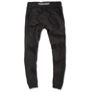 The black Jordan Craig fleece joggers are solid black with tapered ankles