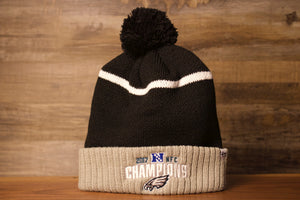 Eagles beanie | Philadelphia eagles beanie NFC champions Black pom beanie this beanie is black with a white line and the cuff is tan with NFC Champions on it