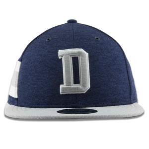 Embroidered on the front of the New Era Dallas Cowboys 9Fifty snapback hat is the D logo in gray