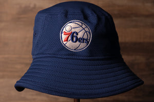76ers Bucket Hat | Philadelphia 76ers Blue Boonie Bucket Hat the front of this bucket hat is blue with the sixers logo on the front