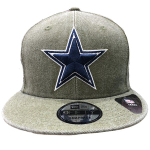 Embroidered on the front of the heather green snapback hat is the Dallas Cowboys logo embroidered in navy blue and white