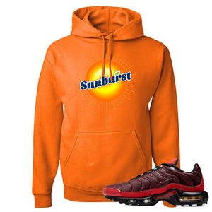 printed on the front of the air max plus sunburst sneaker matching safety orange pullover hoodie is the sunburst soda logo