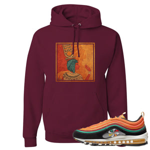 Printed on the front of the Air Max 97 Sunburst maroon sneaker matching pullover hoodie is the Vintage Egyptian logo