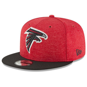 on the front of the atlanta falcons 2018 on field sidline 9 fifty snapback hat is the atlanta falcons logo embroidered in red, black, and white