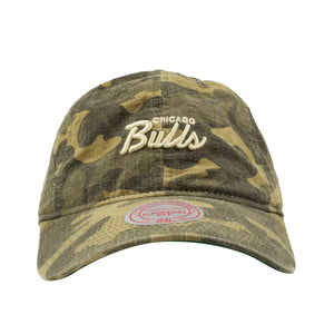Chicago Bulls woodland camouflage dad hat has the word Chicago Bulls in Mitchell and Ness script