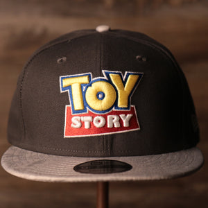 Toy Story Grey Snapback Cap | Toy Story Logo Gray Adjustable Snap Cap the front of this cap has the toy story logo