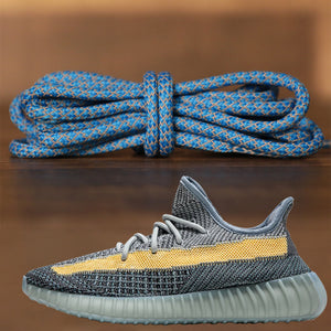 The light blue reflective yeezy matching rope laces alongside the Yeezy Boost 350 V2 Ash Blue sneakers