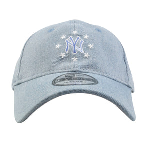 Embroidered on the front of the light denim New York Yankees dad hat is the New York Yankees logo in light blue and white with white stars orbiting the logo