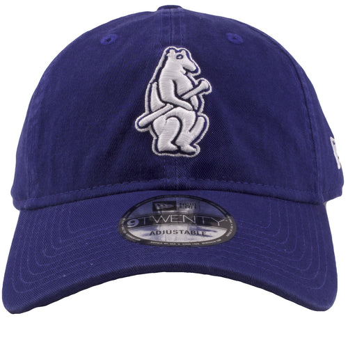 embroidered on the front of the vintage blue chicago cubs dad hat is the throwback wrigley cubs logo