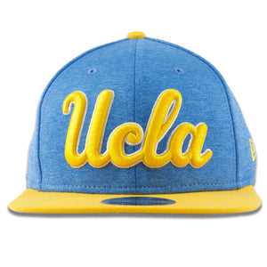 The two tone UCLA snapback hat has the UCLA script lettering embroidered on the front in yellow