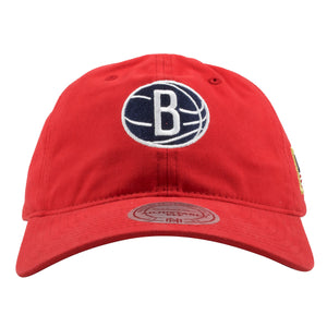 embroidered on the front of the broooklyn nets red dad hat is the brooklyn nets logo in navy blue and white