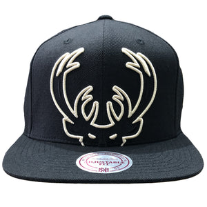 Embroidered on the front of the Milwaukee Bucks snapback hat is the Bucks outlined logo in tan