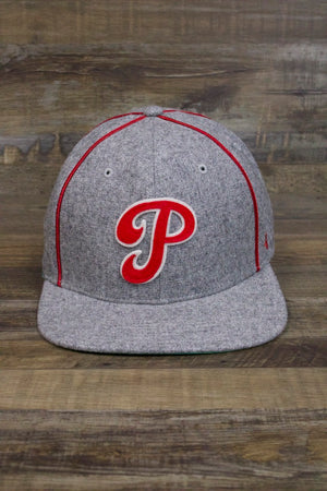 on the front of the Philadelphia Phillies Retro Snapback Hat | Gray Cooperstown Collection Satin Bottom Flat Brim Cap is a curvy retro Phillies P logo