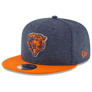 Embroidered on the front of the Chicago Bears 2018 on field snapback hat is the Bears logo in orange and navy blue