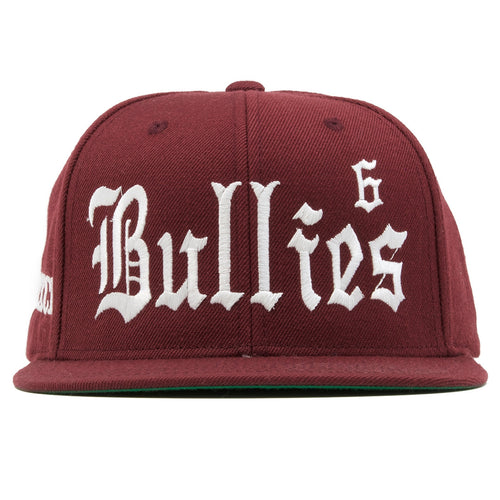 the bullies retro maroon snapback hat is solid maroon