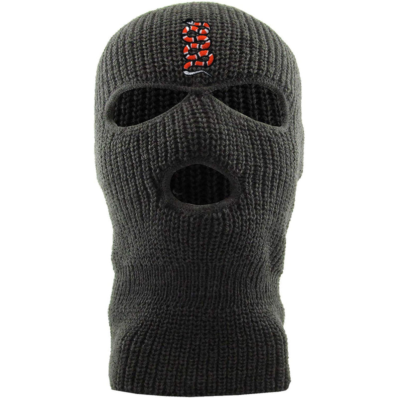 Embroidered on the forehead of the dark gray coiled snake ski mask is the snake logo in red, white, and black
