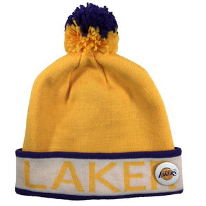 the los angeles lakers mitchell and ness winter beanie has a lakers lettering in yellow with the los angeles lakers pin