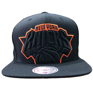Embroidered on the front of the new york knicks black snapback hat is a knicks logo embroidered in black and orange