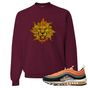 Printed on the front of the Air Max 97 Sunburst maroon sneaker matching crewneck sweatshirt is the Vintage Lion Head logo