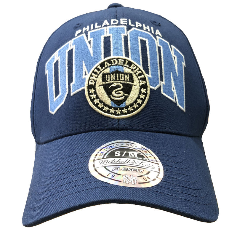 Embroidered on the front of the Philadelphia Union navy blue mitchell and ness stretch fit cap is the Philadelphia Union logo along with the words Philadelphia Union