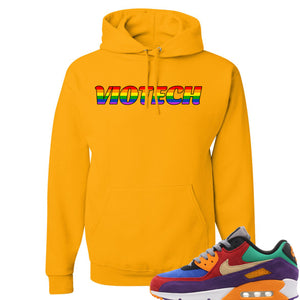 Printed on the chest of the viotech air max 97 gold sneaker matching pullover hoodie is the viotech gaypride logo in a rainbow colorway